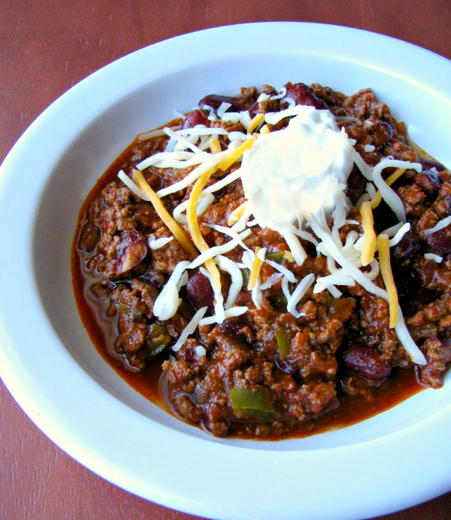 Spicy ground beef, slow cooker, award winning chili! Just brown the ground beef, put it in a slow cooker, add some delicious beans, veggies, and spices and cook! Simple, easy, delicious!