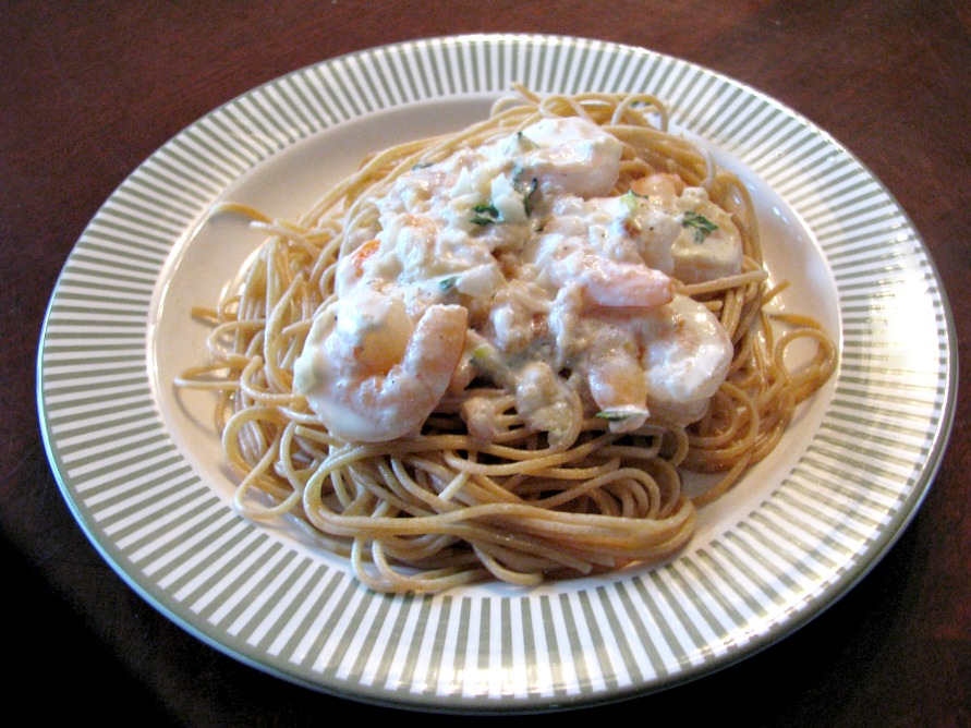 Shrimp in a Lemon Thyme Cream Sauce- Deliciously seasoned shrimp in a lemon thyme cream sauce. Easy to make, using pre-cooked shrimp, this change-up to regular spaghetti night is ready in 30 minutes!