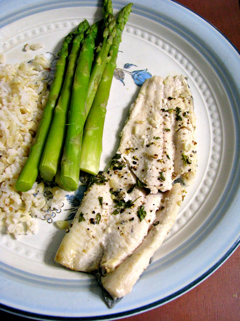 Quick, easy pan seared lemon pepper rainbow trout, with fresh squeezed lemon juice, fresh ground pepper, and garlic makes an easy weeknight dinner.