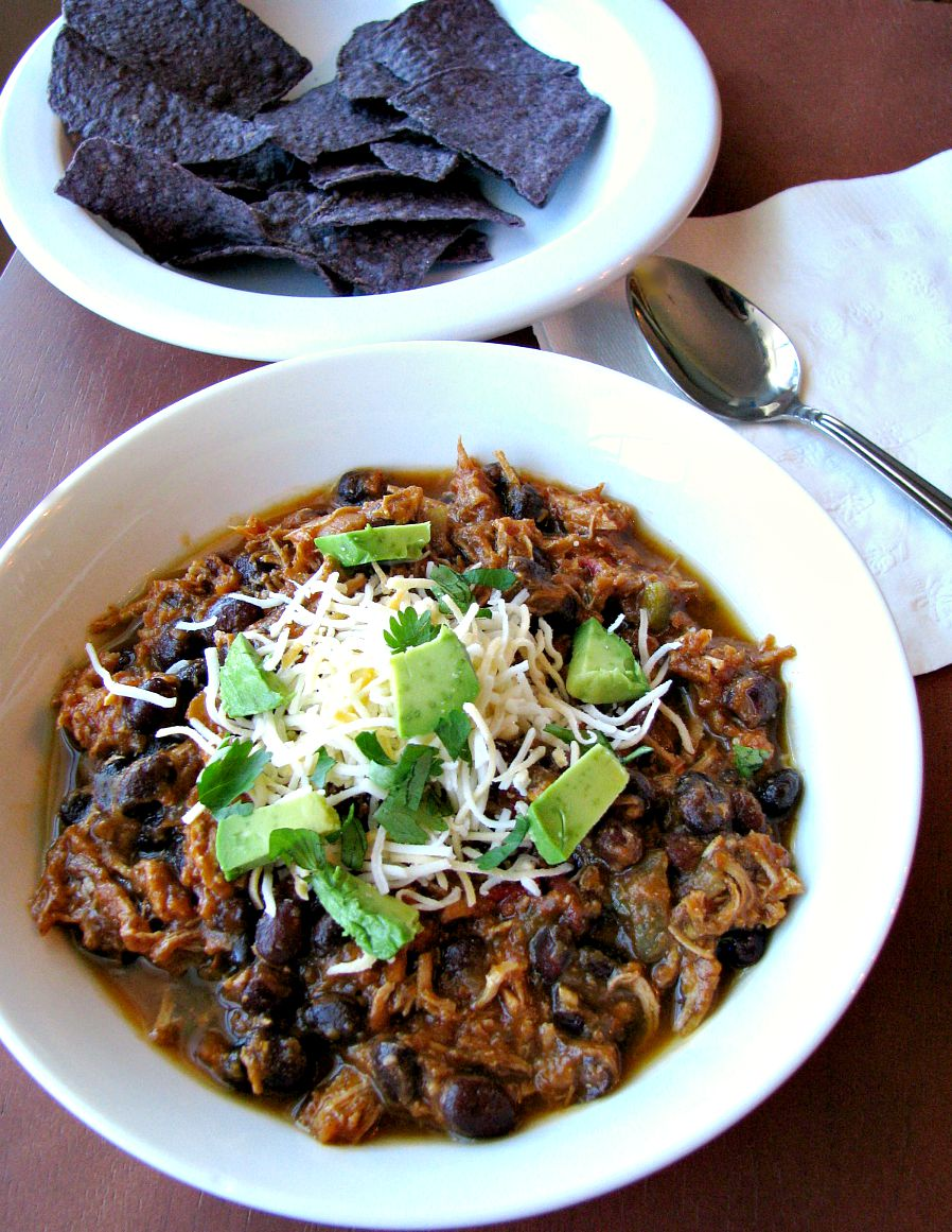 Southwest Chicken Pumpkin Chili made in the slow cooker with shredded chicken breasts, black beans, hot salsa, and pumpkin puree simmered in chicken stock. This chili is full of flavor, not too spicy, and healthy!