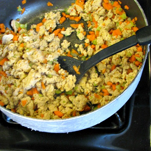 Browning ground chicken, carrots, and celery.