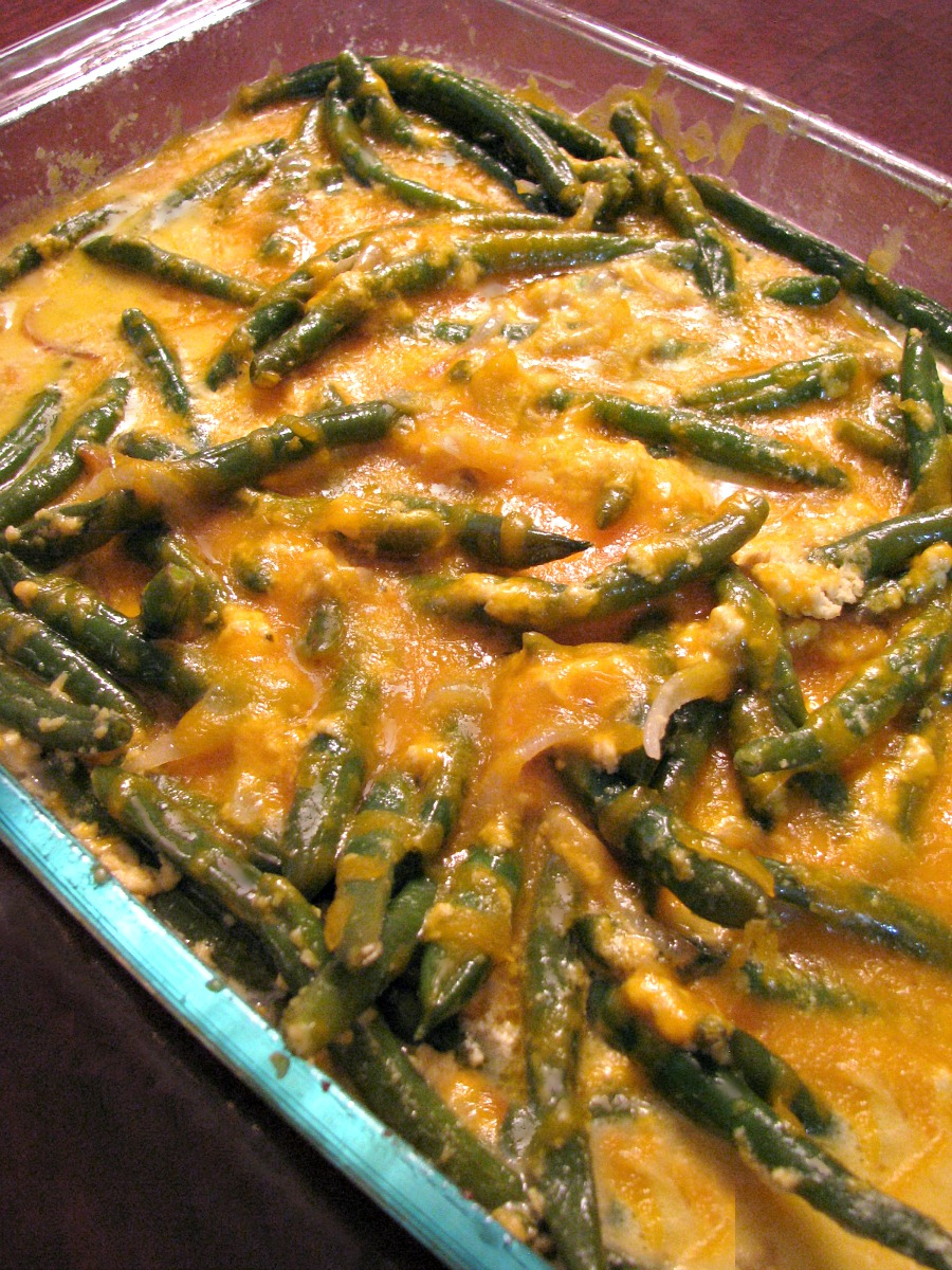 Fresh Green Bean Casserole- This non-traditional green bean casserole is made with fresh green beans and caramelized onions in a cheddar cheese sauce. The perfect Thanksgiving side dish!