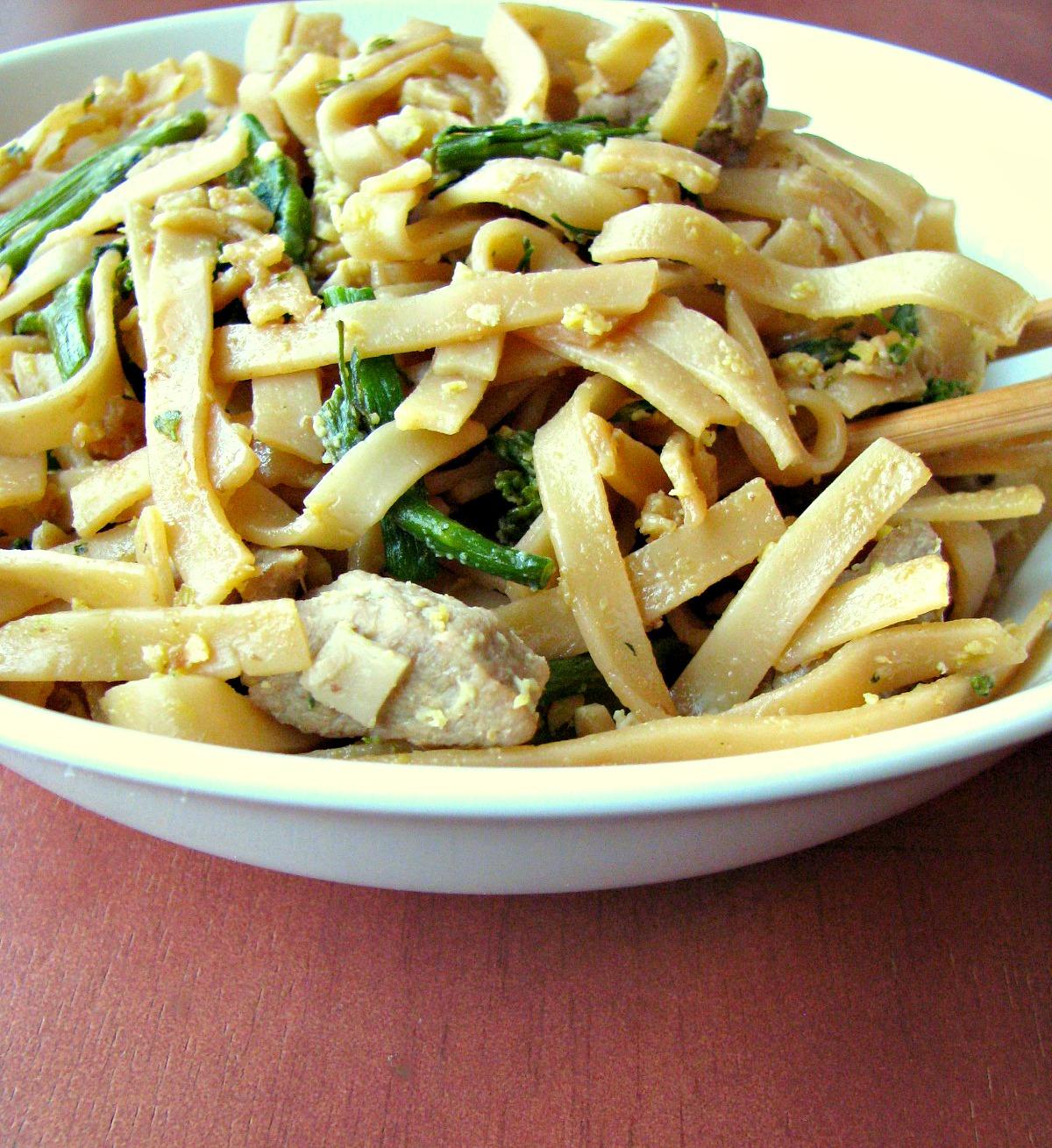 "Pad See Ew ( meaning ""fried with soy sauce"") is made with large rice noodles, pork loin, broccoli, and scrambled eggs fried in soy sauce. Makes a great weeknight dinner and better than takeout!"